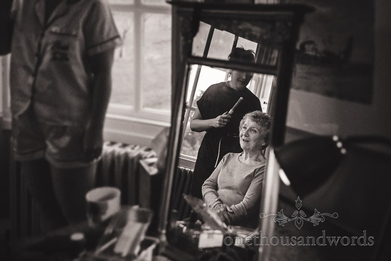 Mother of the bride during morning preparations at country house wedding
