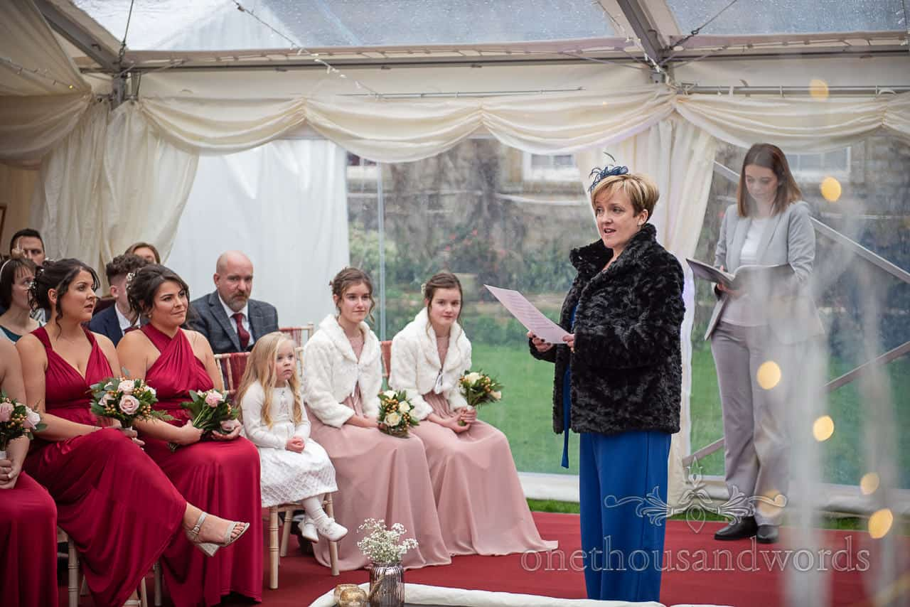 Reading delivered at country house marquee wedding ceremony
