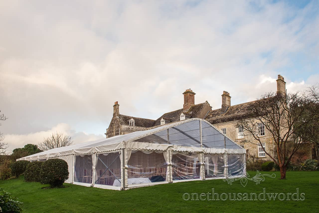 Smedmore House wedding photographs of clear span marquee in the rear garden at a country house wedding venue in Dorset