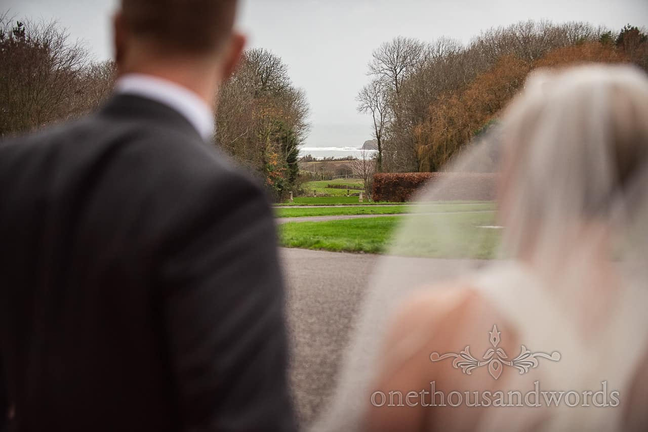 View of Kimmeridge Bay Dorset coast in the mist from Smedmore House wedding group photographs by one thousand words photography