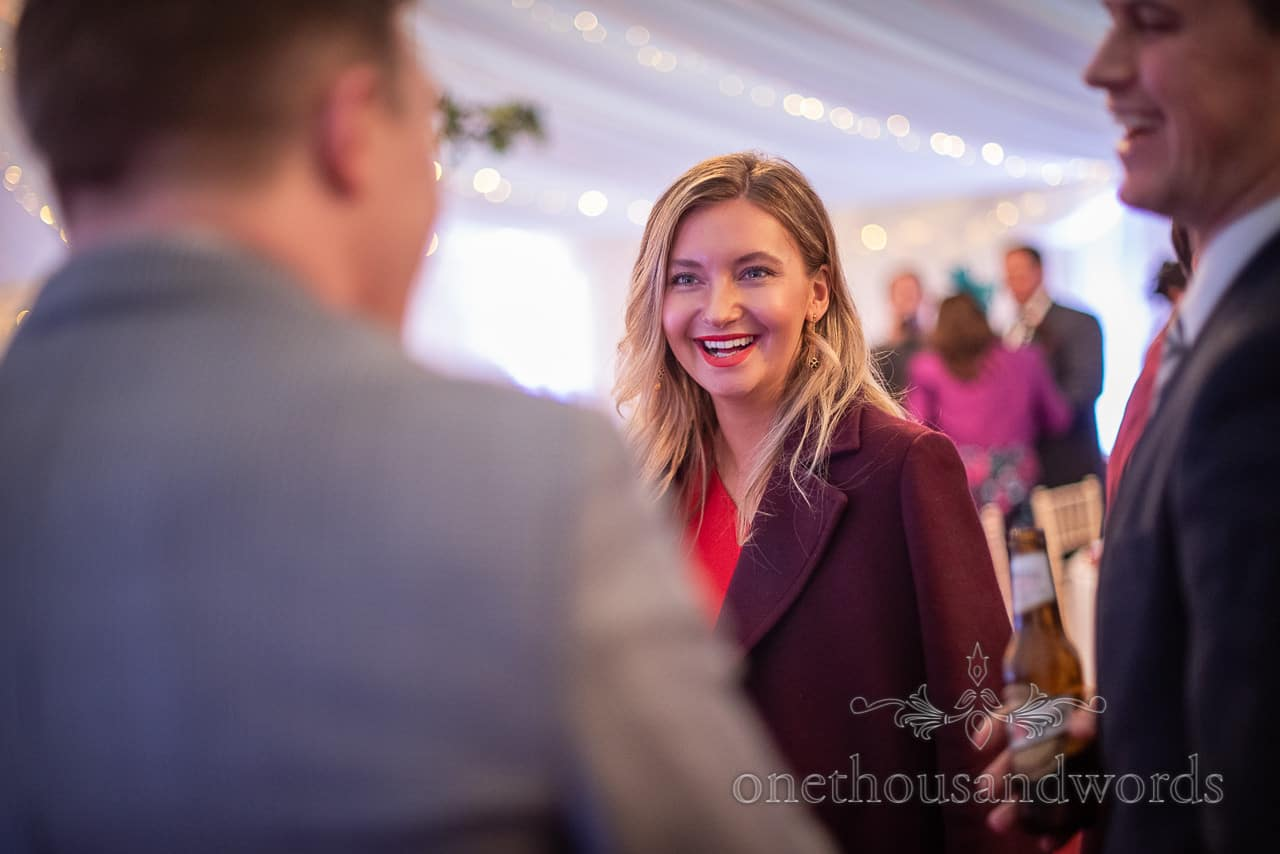 Portrait photograph of happy smiling guest during white wedding marquee wedding reception by one thousand words wedding photography