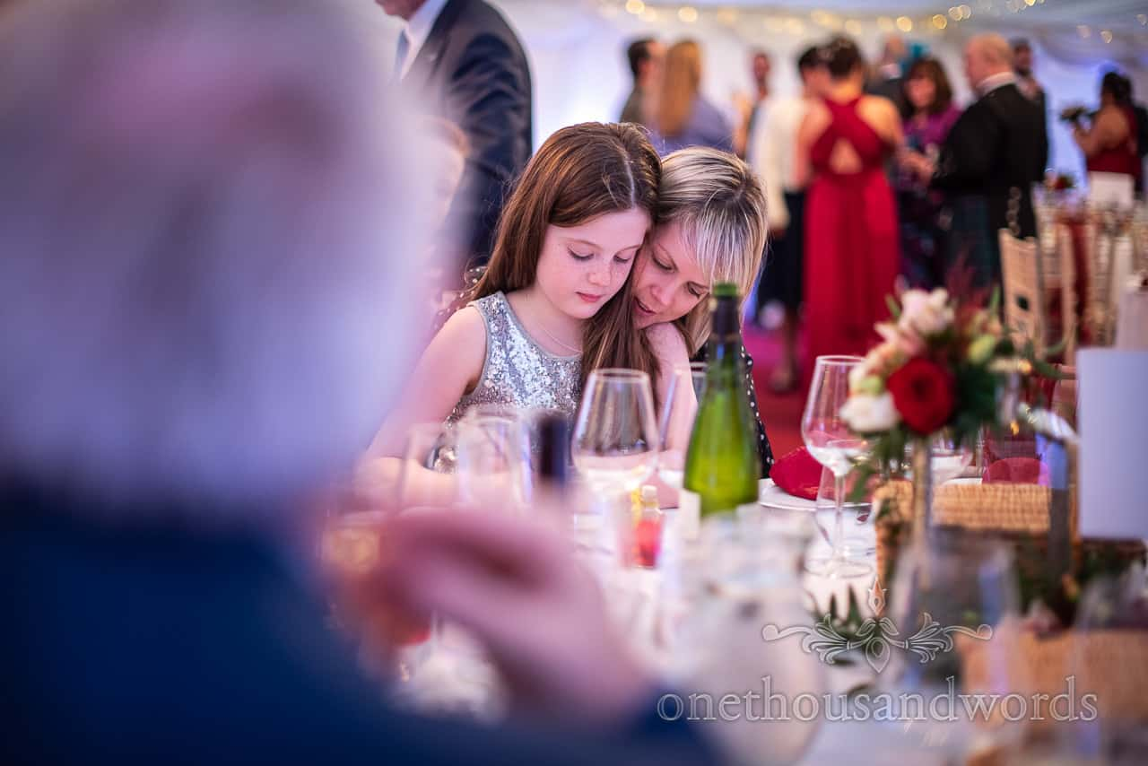 Young wedding guest has a hug from mum during Smedmore House wedding breakfast