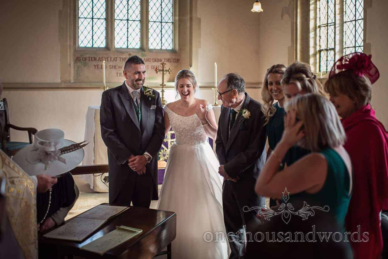 Bridal party after register is signed at Lulworth Estate church wedding