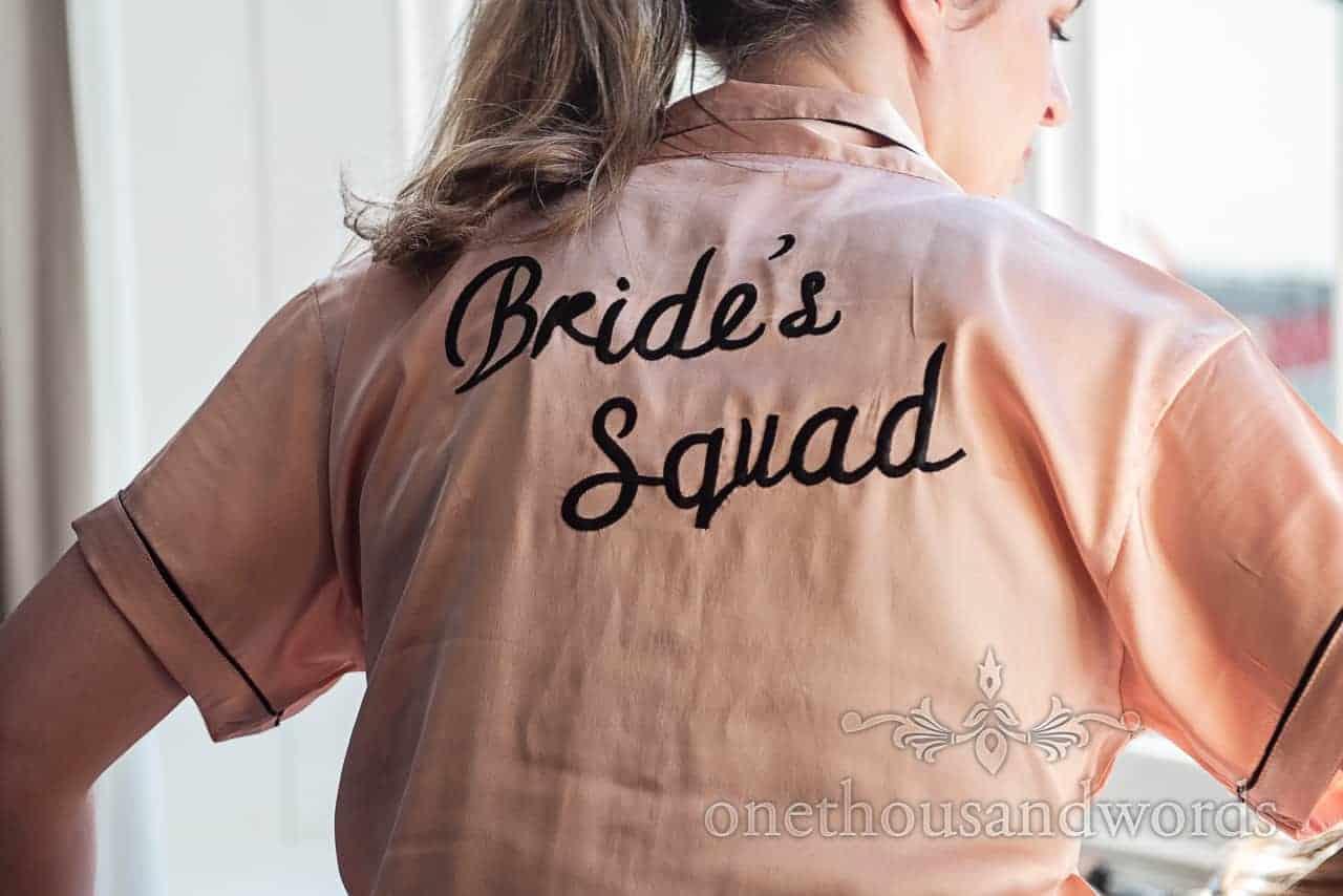Bride wears peach coloured bride squad pajamas