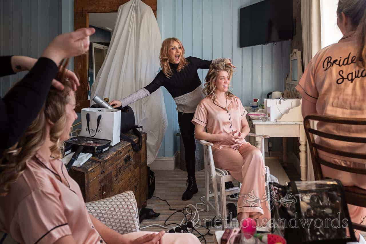 Bride and bridesmaids have hair styled at Lulworth Cove Inn on wedding morning