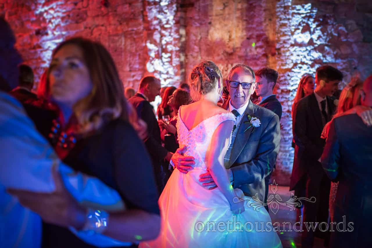 Bride and father dancing during evening reception at Lulworth Estate wedding