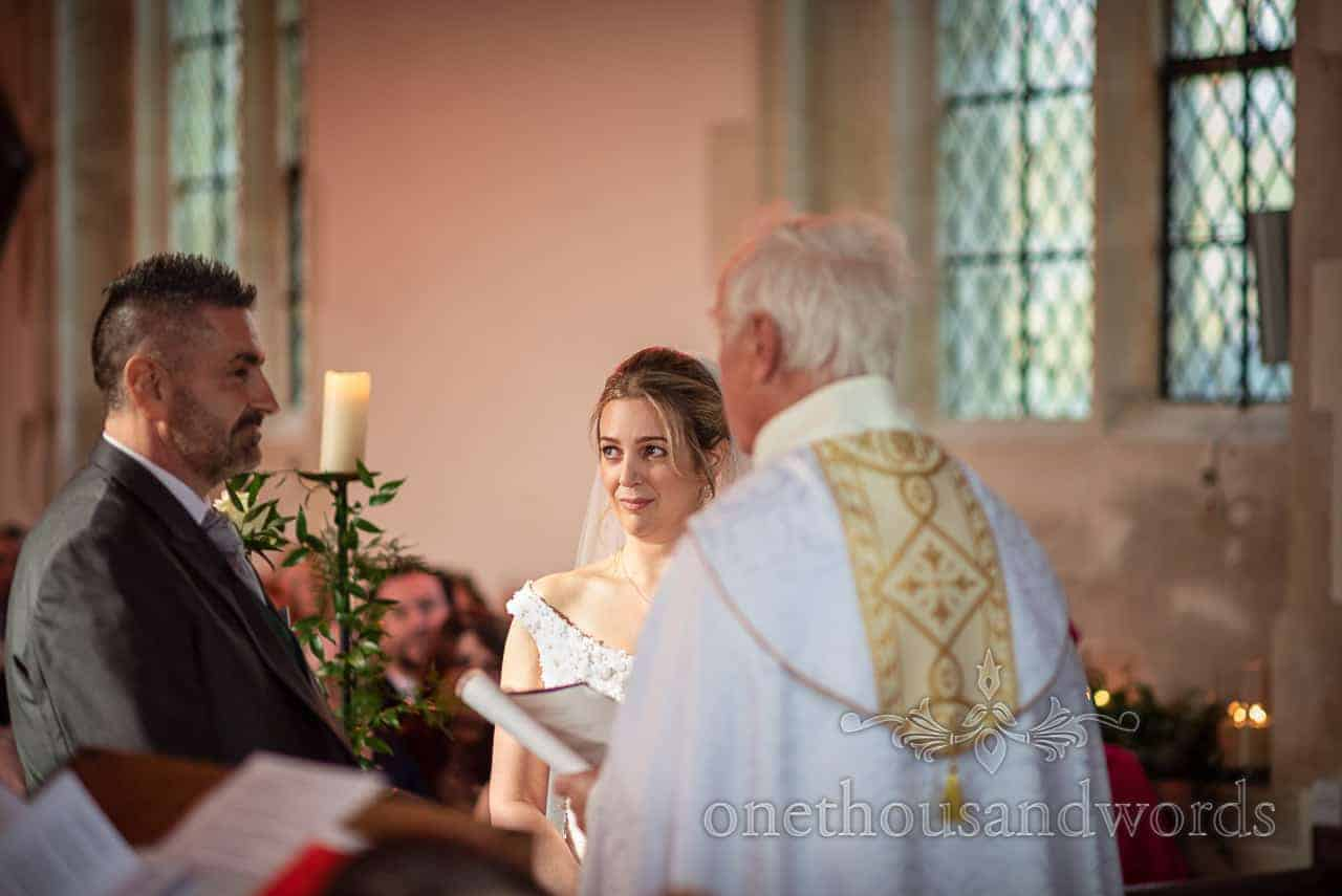 Bride and groom say vows during Lulworth Estate church wedding ceremony