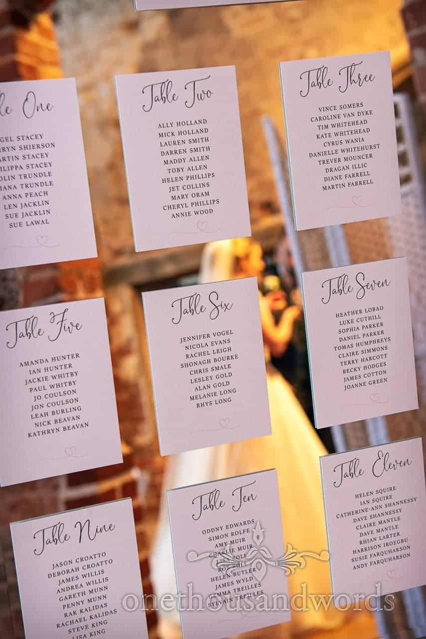 Bride reflection in mirror table plan from Lulworth Castle wedding reception
