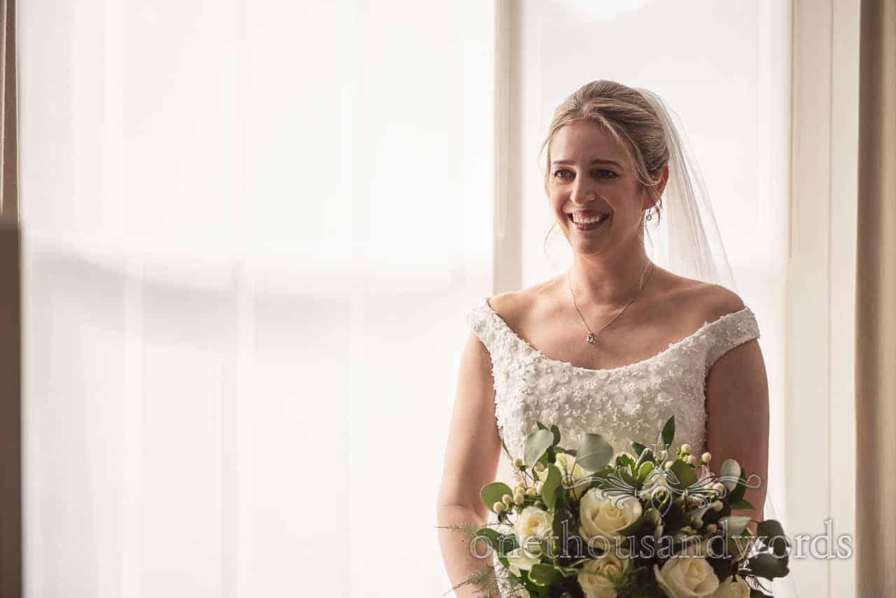 Happy bride wedding ready holding fresh flower bouquet