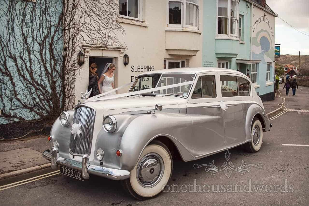 Classic car collects bride and father for Lulworth Estate wedding