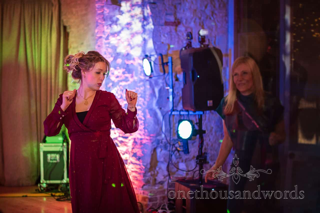 Dancing guests throwing shapes at Lulworth Castle wedding reception