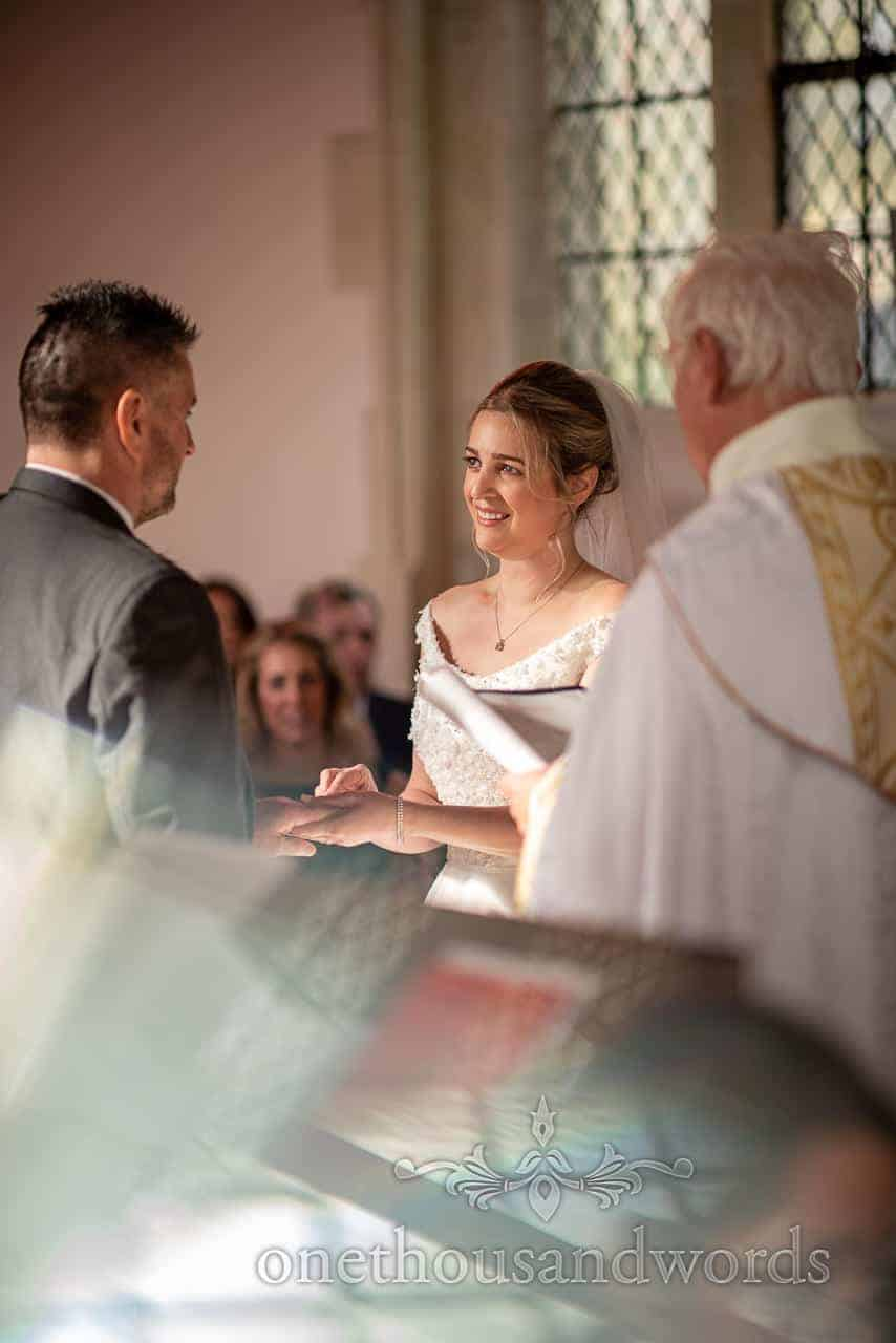 Exchange of rings in traditional English church ceremony photograph