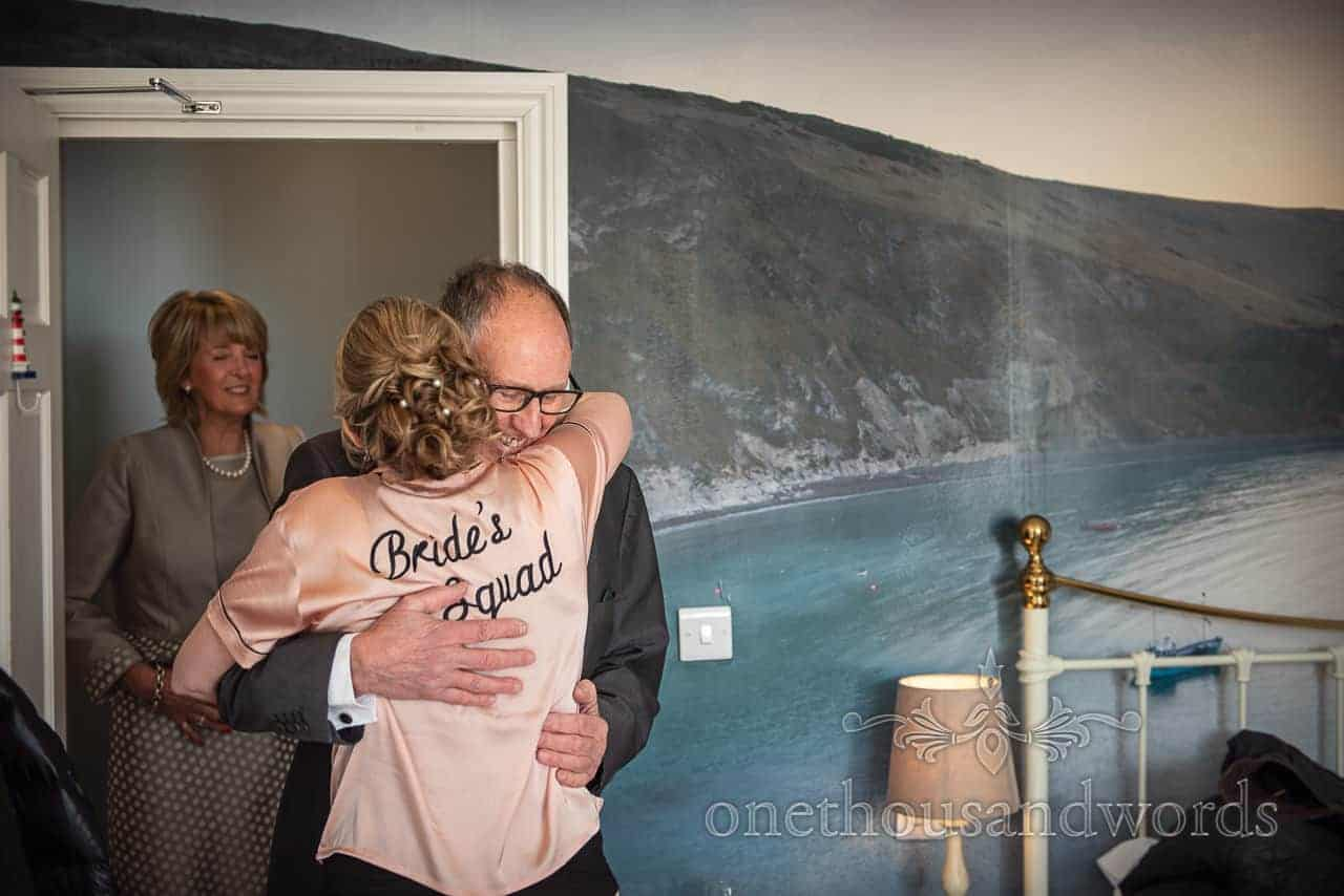 Father of the bride and bride emotional embrace photograph