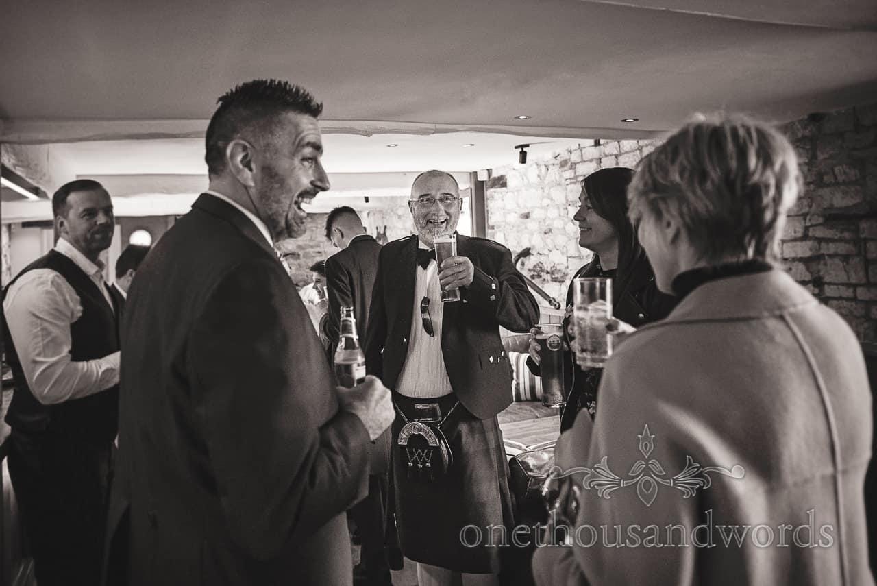 Groom and groomsmen at Lulworth Estate pub on wedding morning