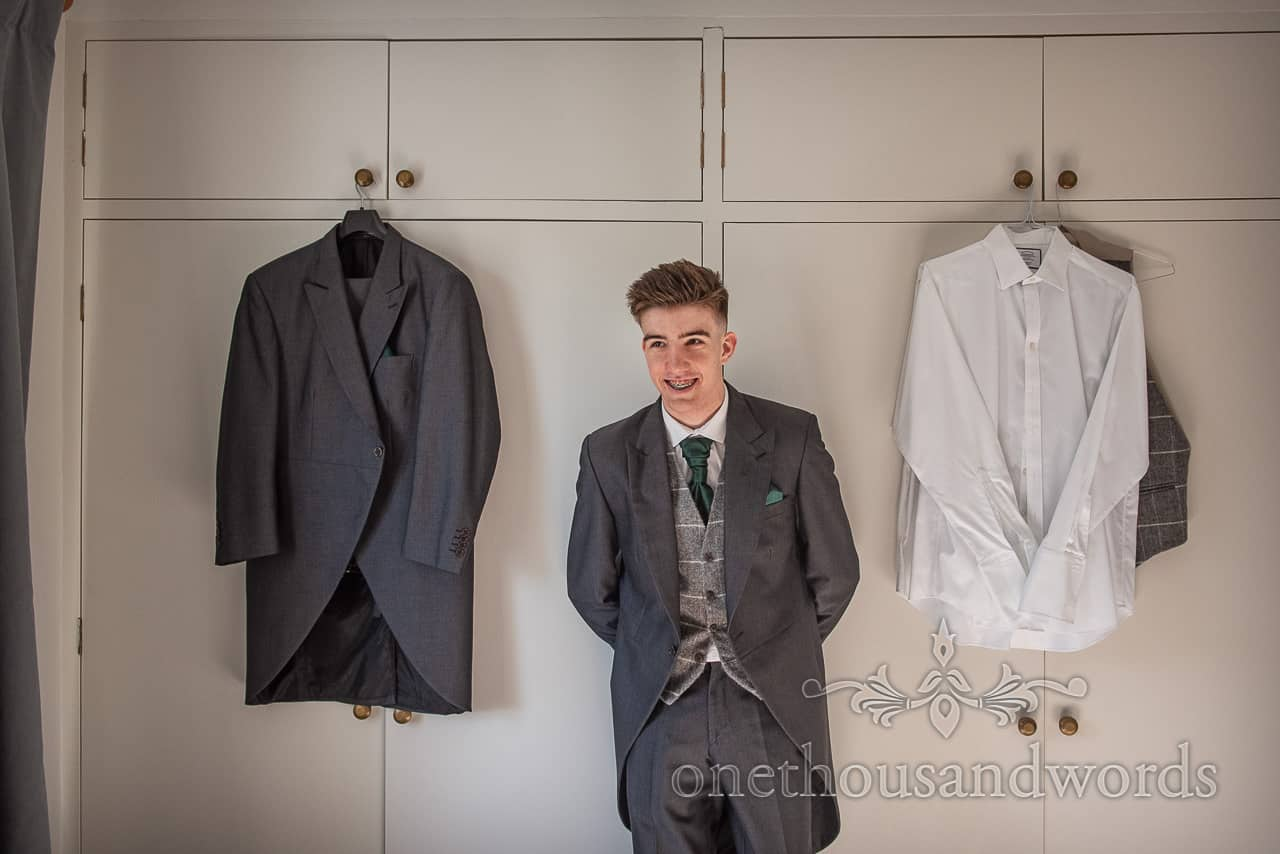 Grooms son in grey morning suit and waistcoat on Lulworth wedding morning