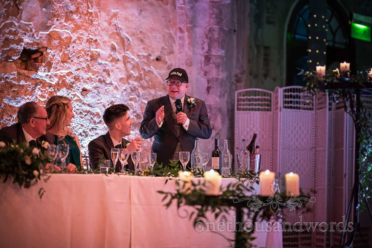 Groomsman delivers speech wearing Cap at Lulworth Estate wedding photographs