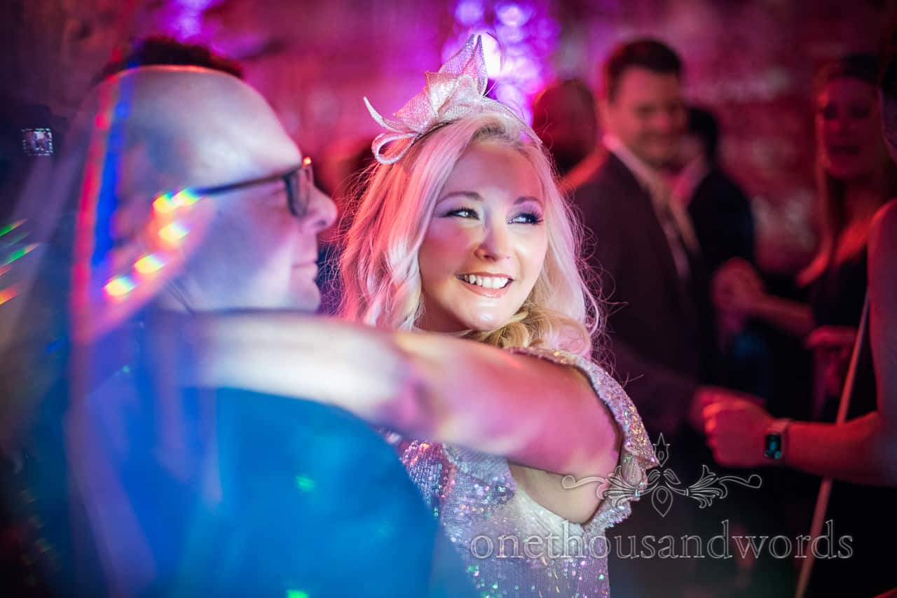 Groomsman and wife dancing at Lulworth Estate wedding photographs