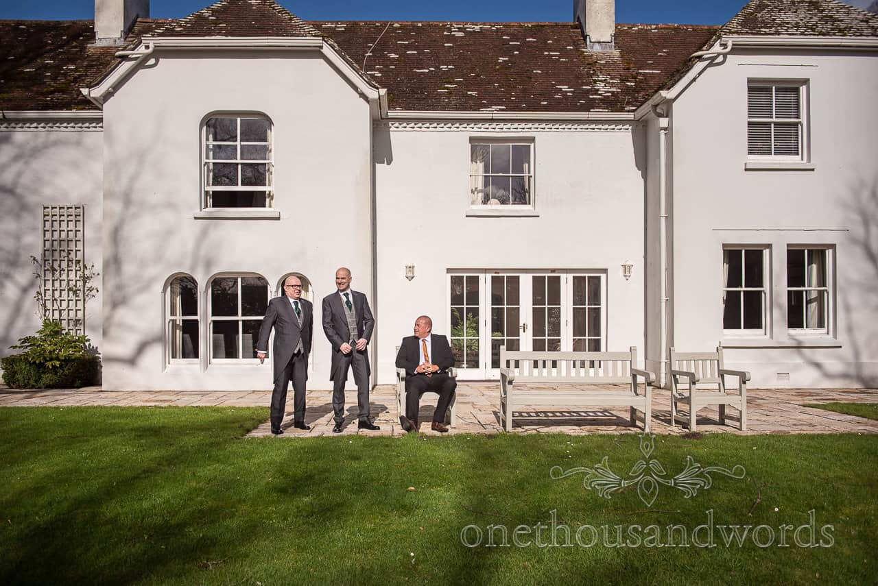 Groomsmen and guest In sunshine at The Lindens garden in Lulworth
