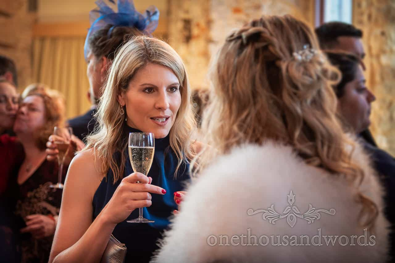 Female guest during drinks reception at Lulworth Estate wedding