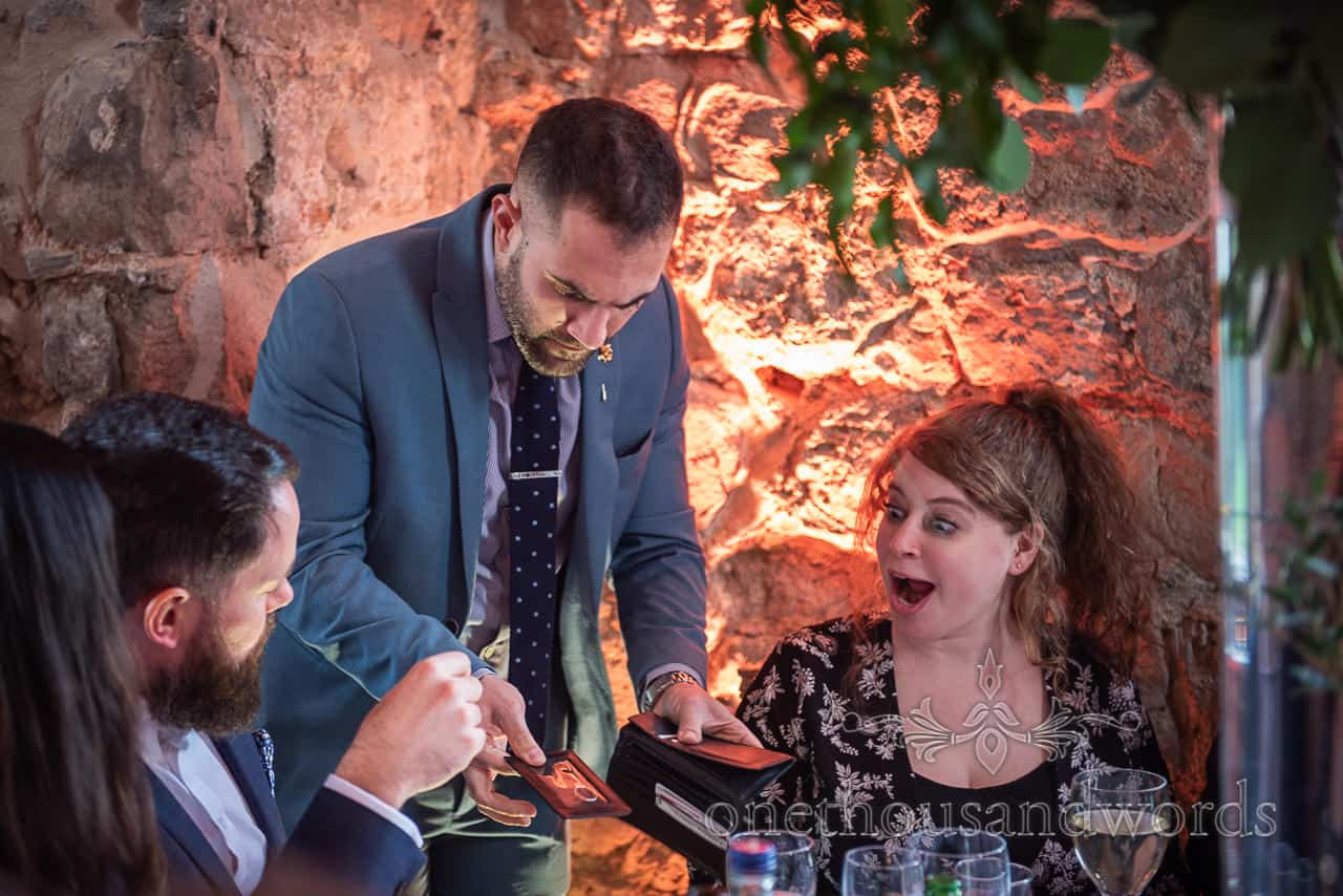 Guest reaction to magicians trick at Lulworth Castle wedding
