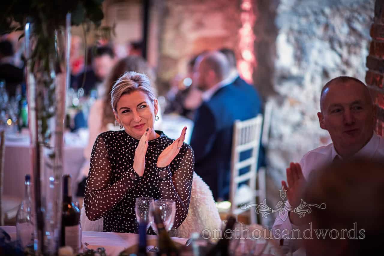 Guests applaud speech at Lulworth Estate wedding reception