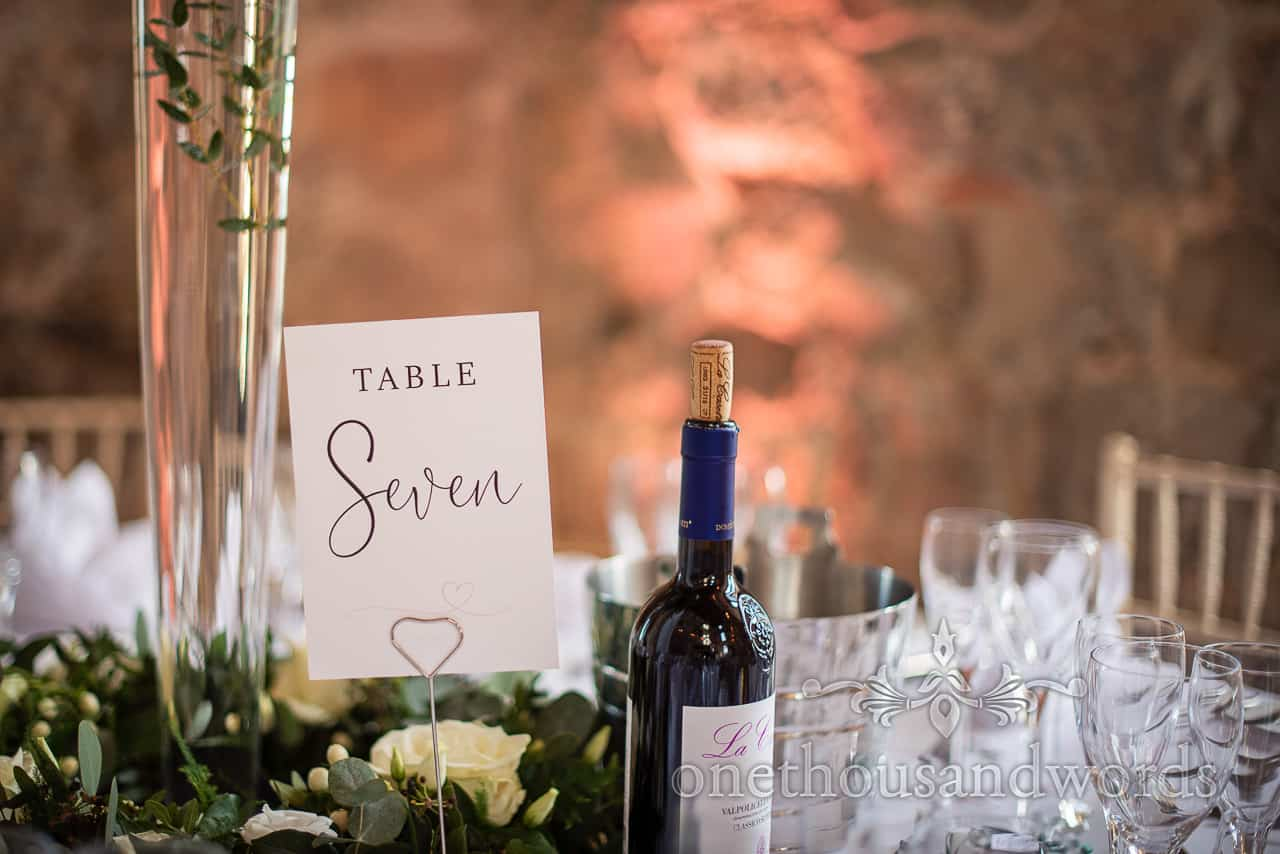 Hand writing script wedding table number sign at Lulworth reception