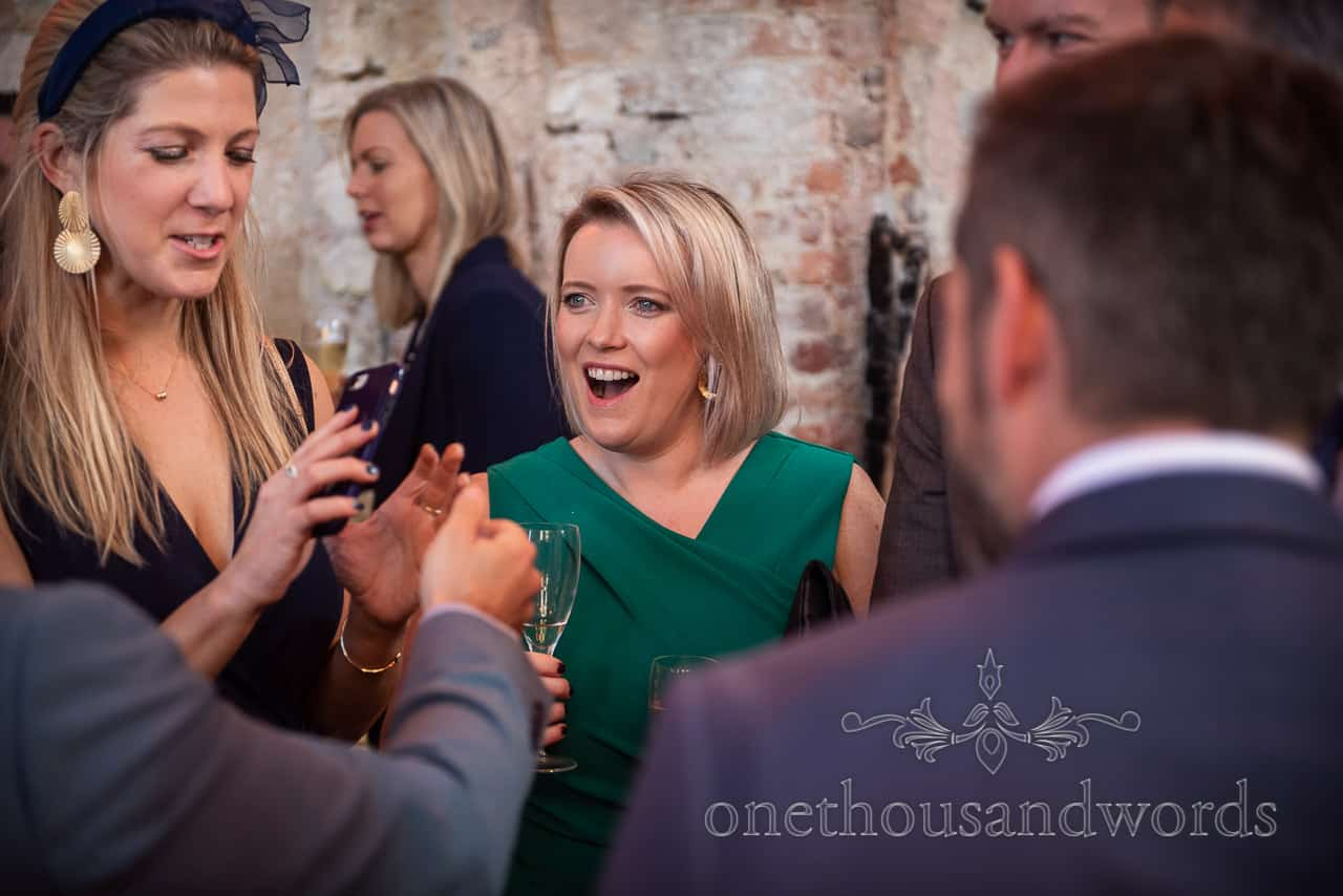 Laughing guest during drinks reception at Lulworth Castle