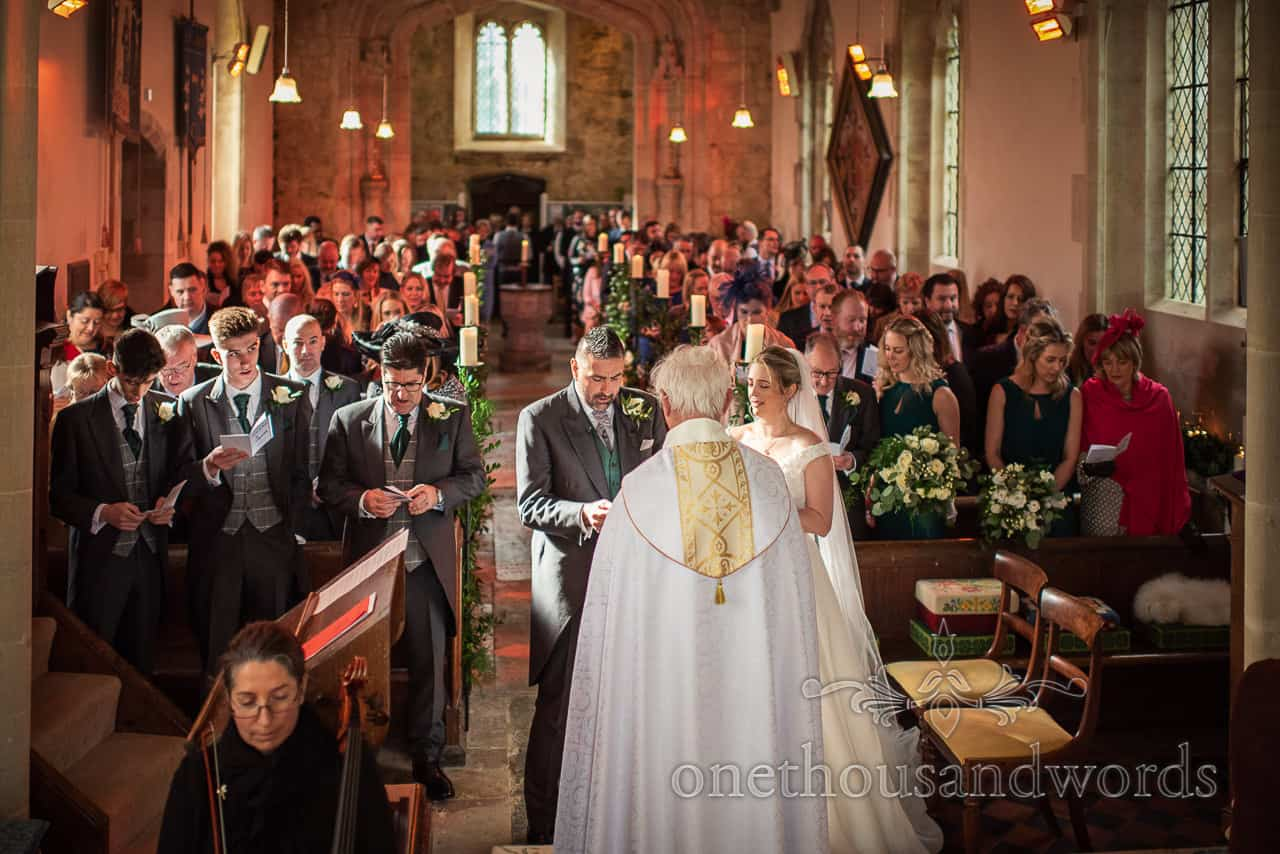 Looking down the aisle at Lulworth Estate wedding photographs