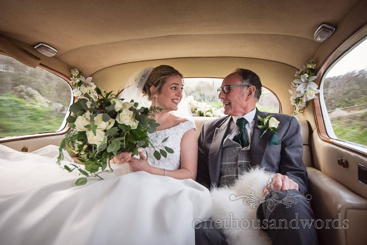 Lulworth Estate wedding photographs of bride and father on way to church