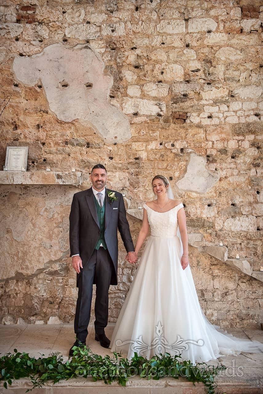 Lulworth Estate wedding photographs of bride groom inside castle