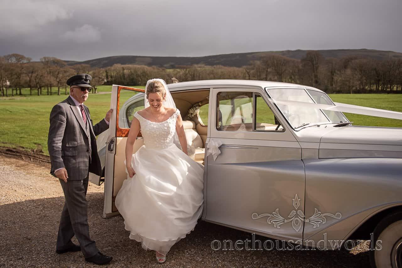 Lulworth Estate wedding photographs of brides arrival