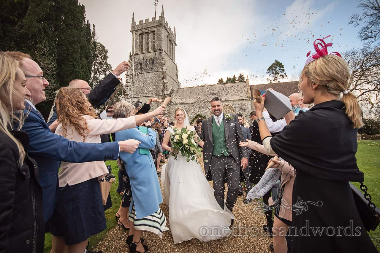 Lulworth Estate wedding photographs of newlyweds as they are with showered confetti