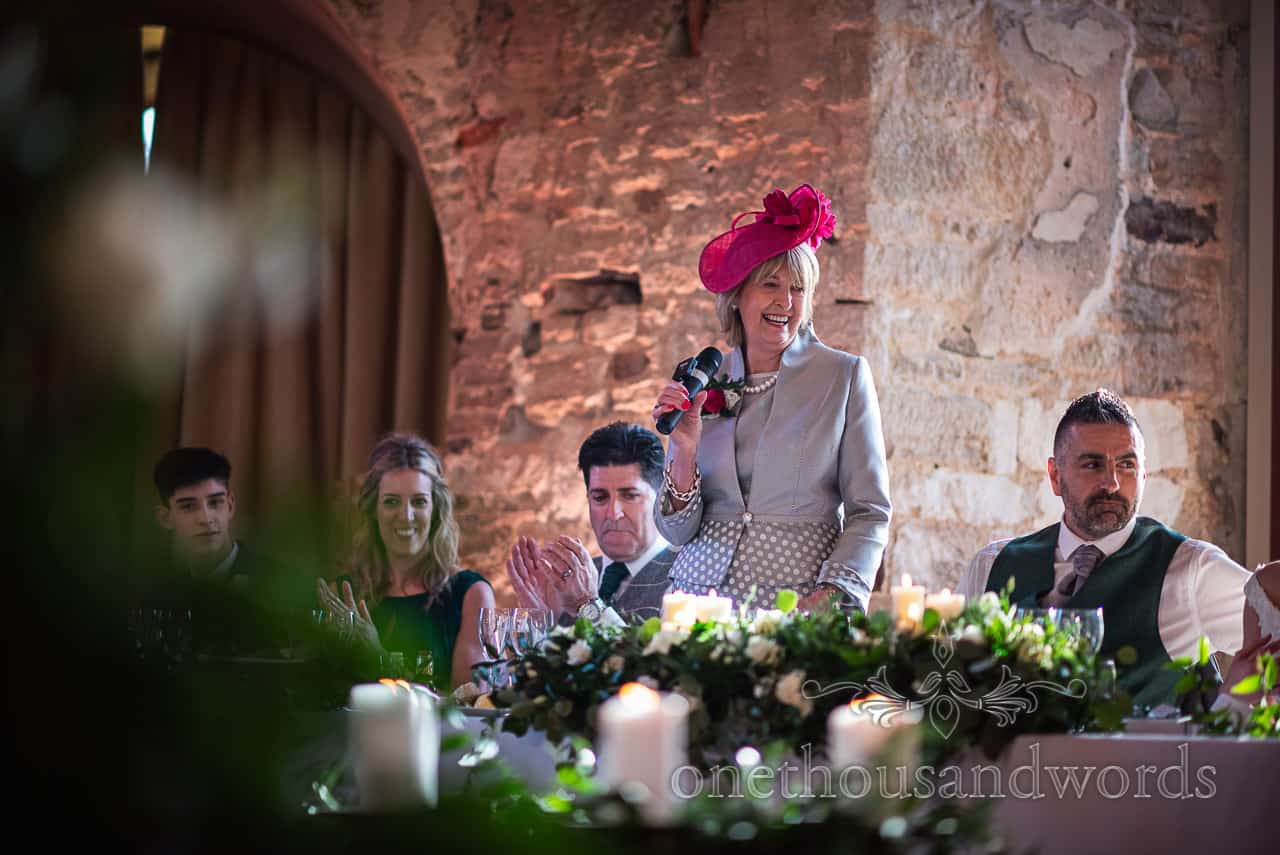 Mother of the bride delivers speech from top table at Lulworth Castle wedding