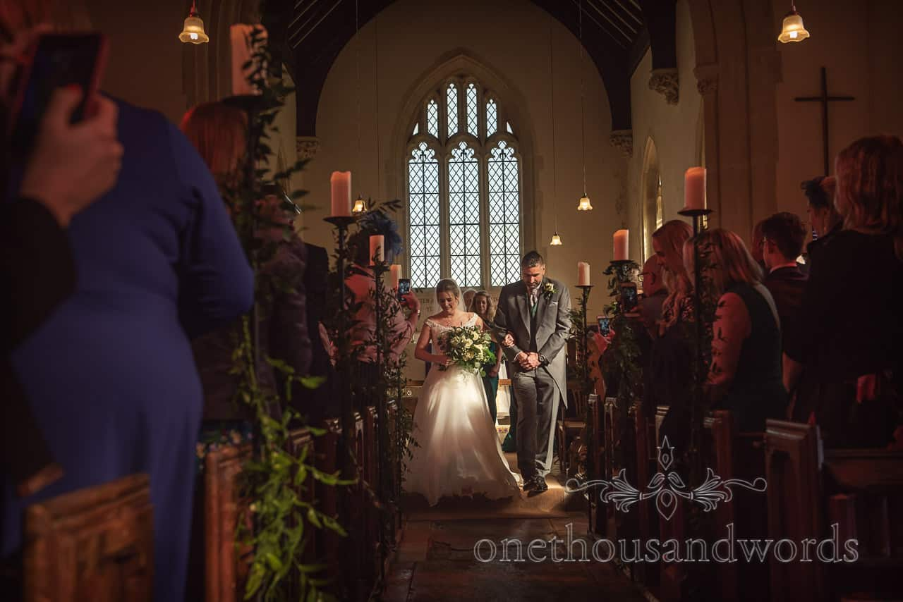 Newlyweds come down the aisle at traditional church marriage