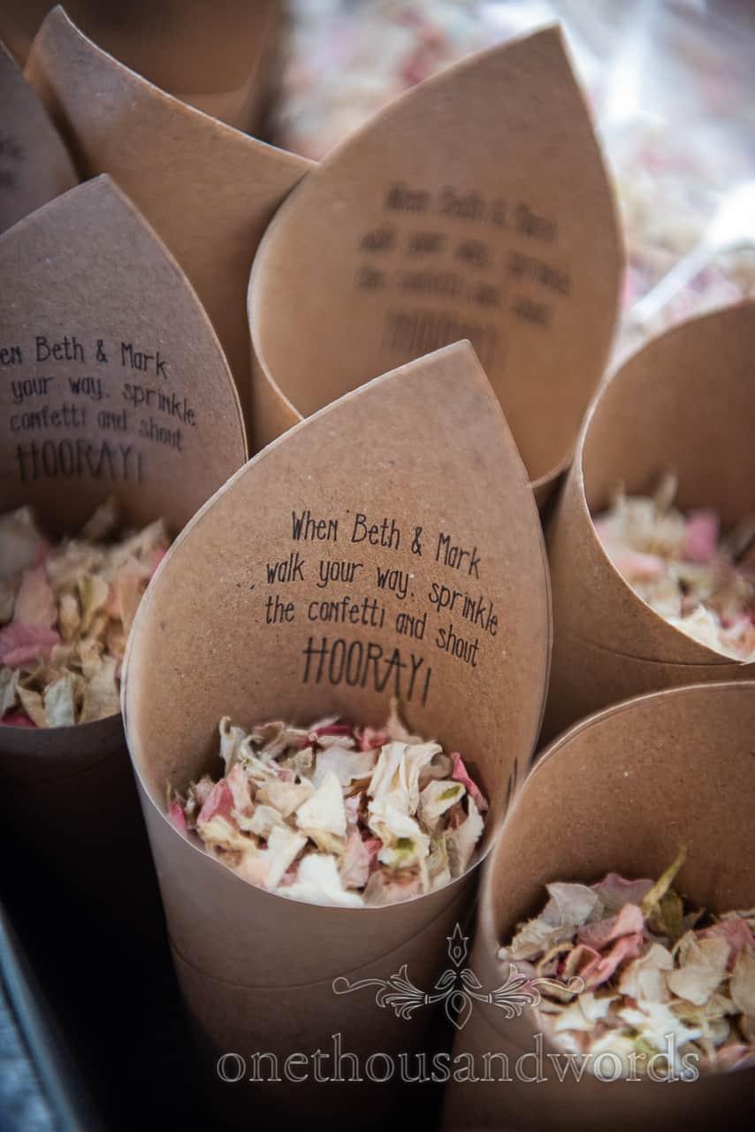 Personalised confetti cones full of petals from Lulworth Estate wedding