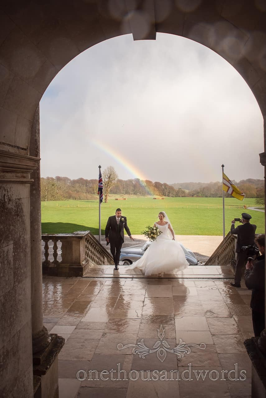 Rainbow appears behind newlyweds as they arrive at Lulworth Estate wedding