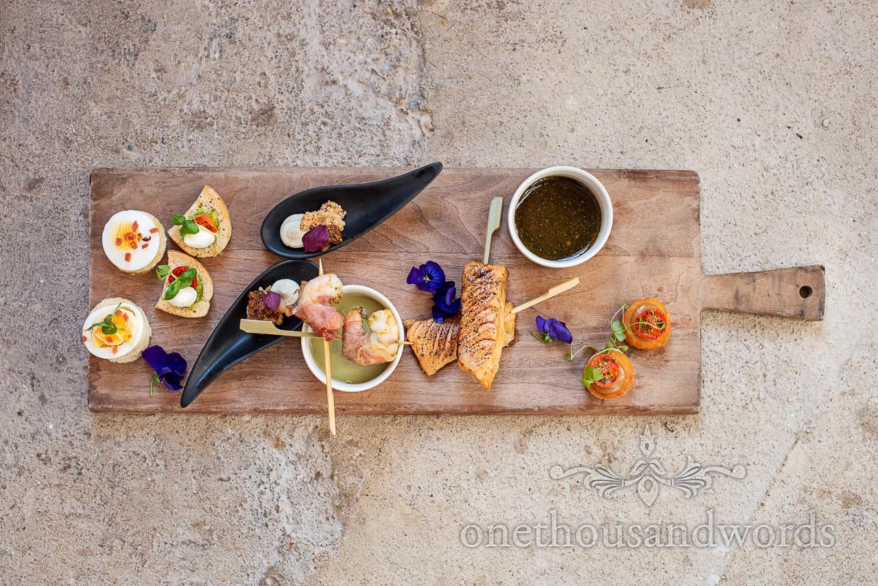 Serving board full of tasty canapés by Beales gourmet catering
