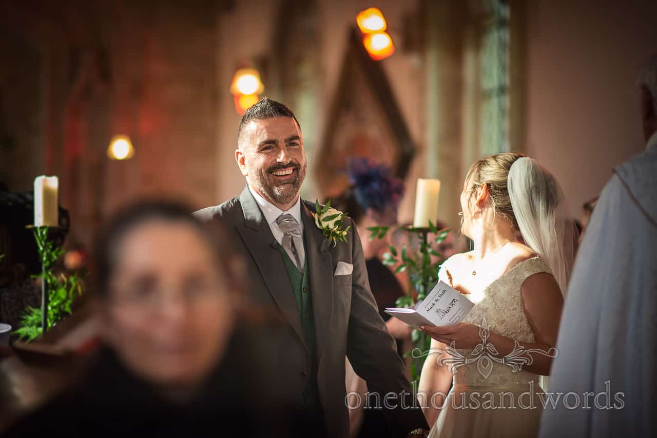 Smiling groom at Lulworth Estate church wedding ceremony