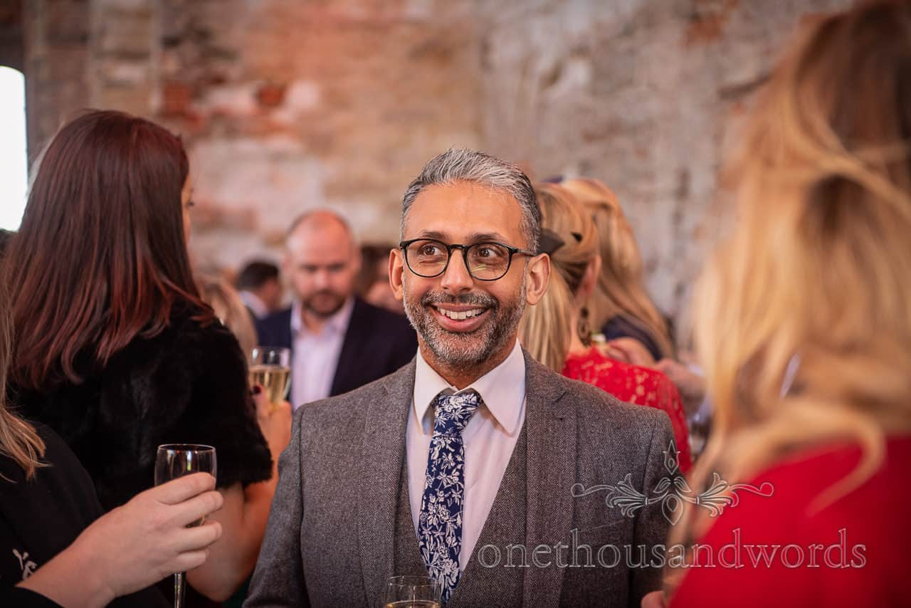 Smiling guest during drinks reception at Lulworth Castle