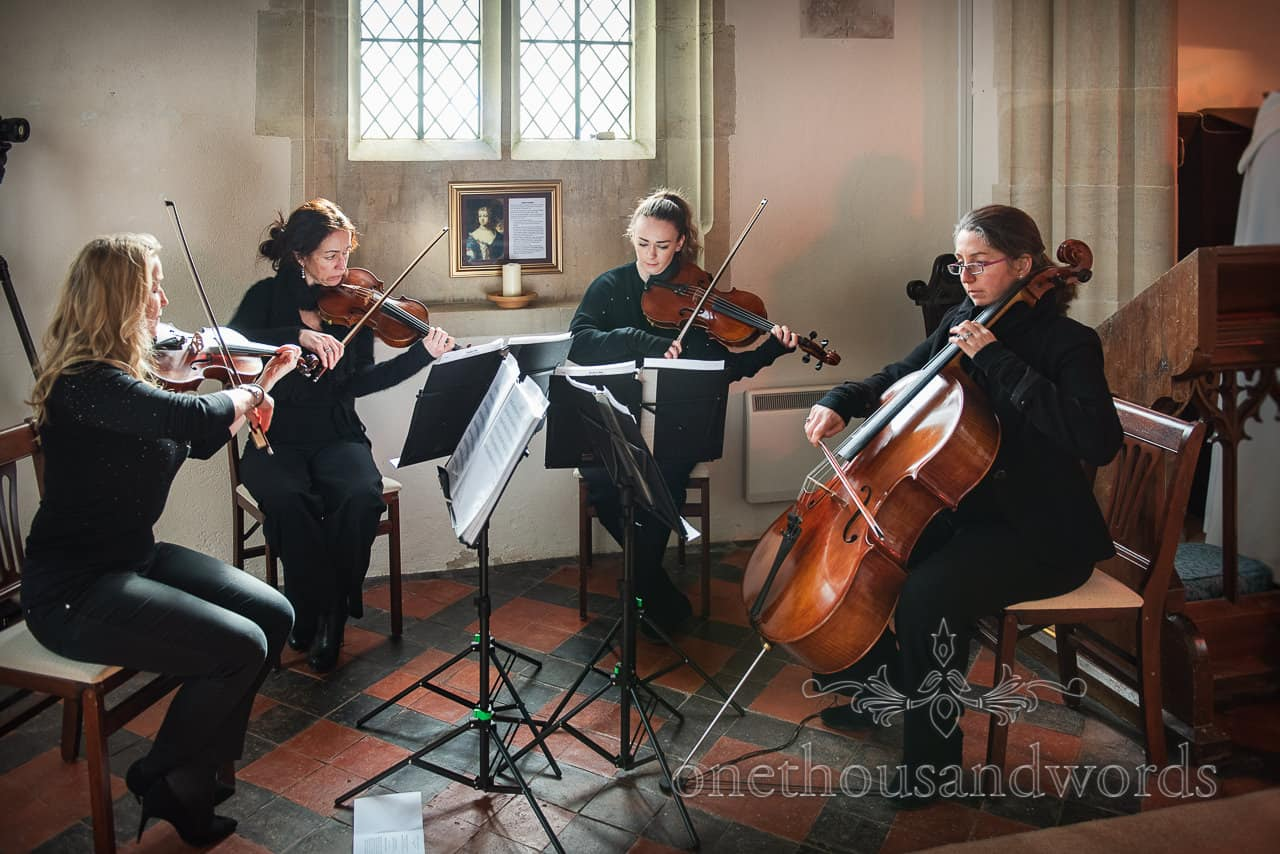 String quartet perform at Lulworth Estate church wedding