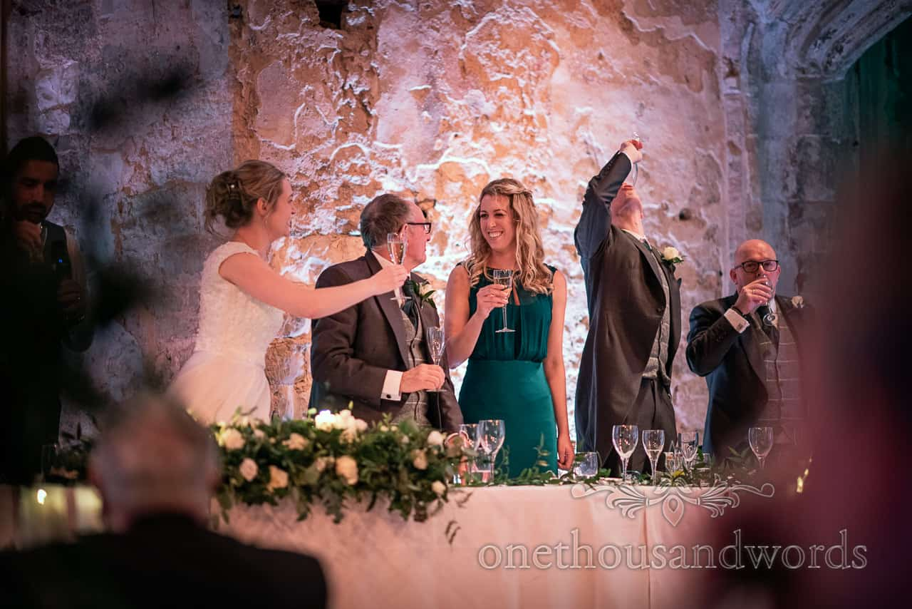 Top table stand for toast at Lulworth Estate wedding photographs