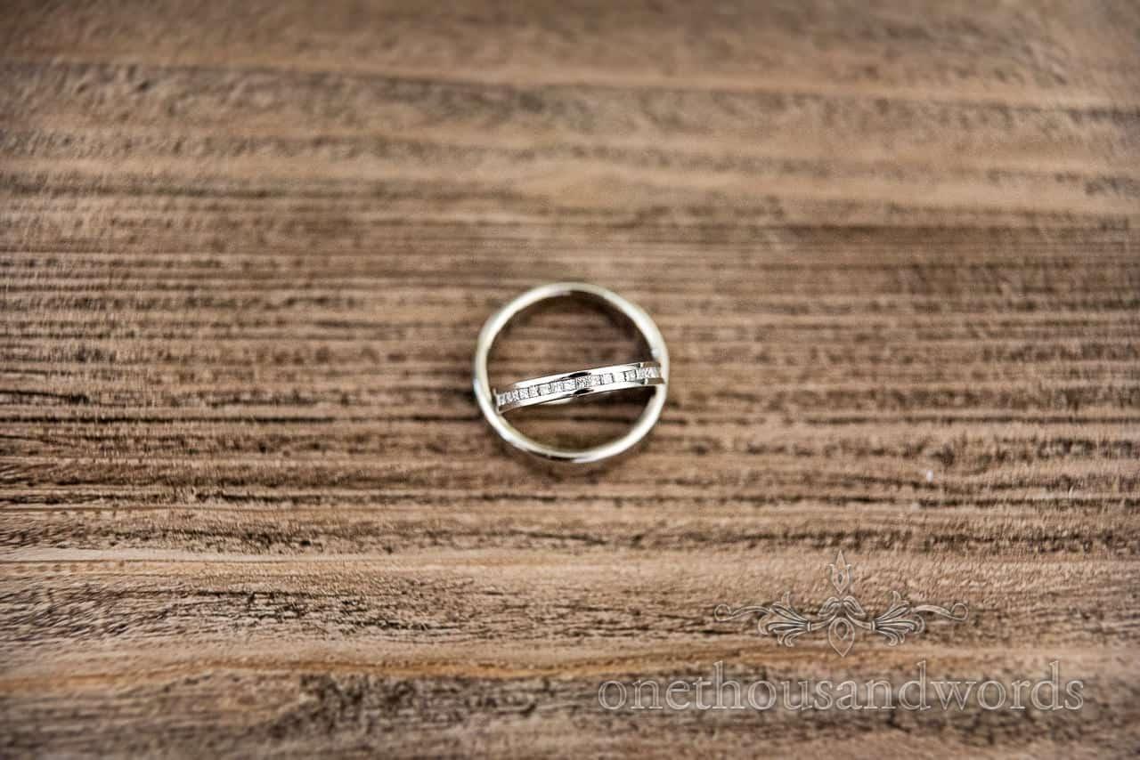 Wedding rings against wood grain from wedding morning