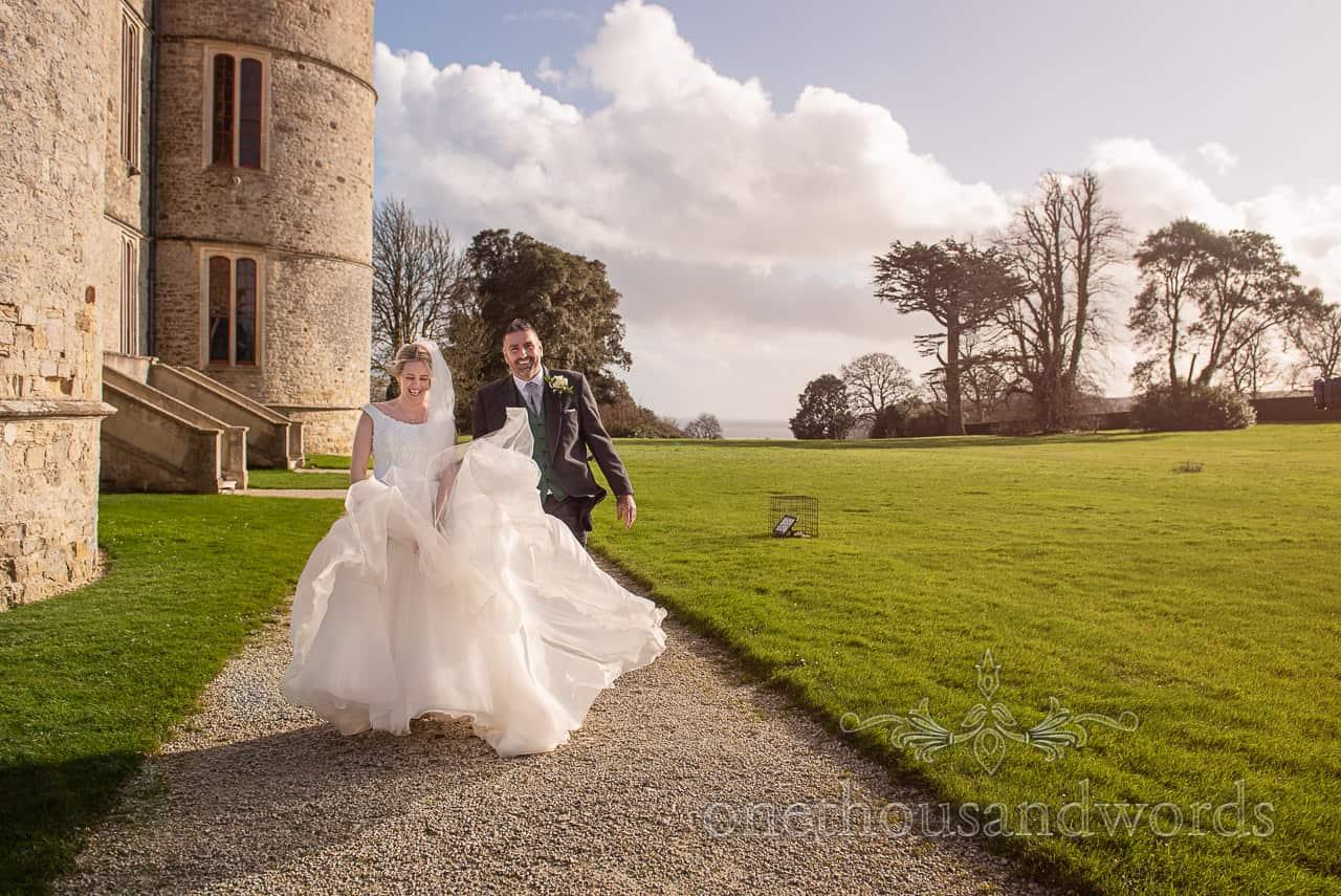 Windswept newlyweds from Lulworth Estate wedding photographs