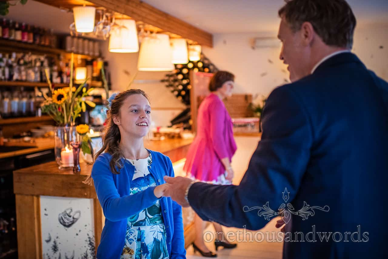 Grooms daughter learns to swing dance at wedding evening reception