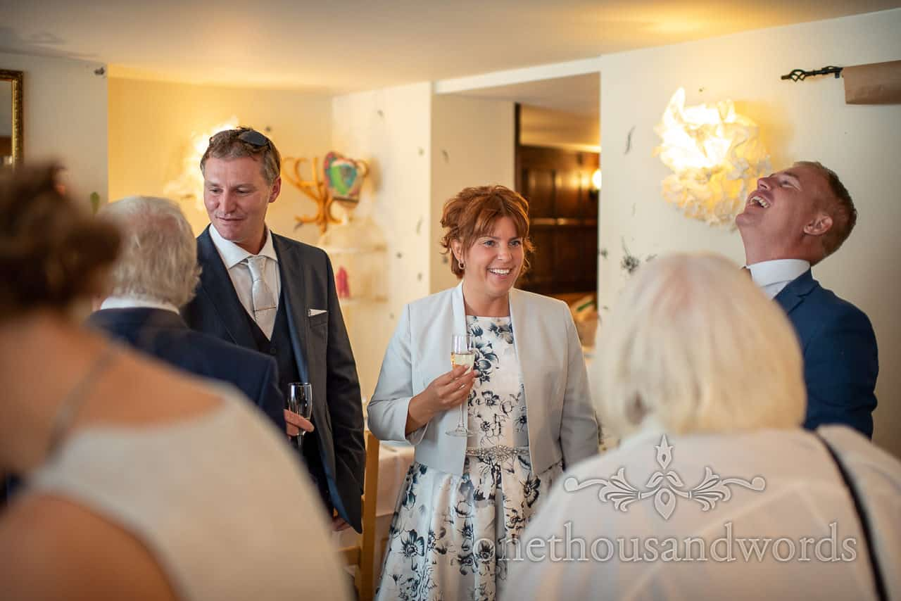 Bride and groom welcome wedding party to Dorset restaurant drinks reception