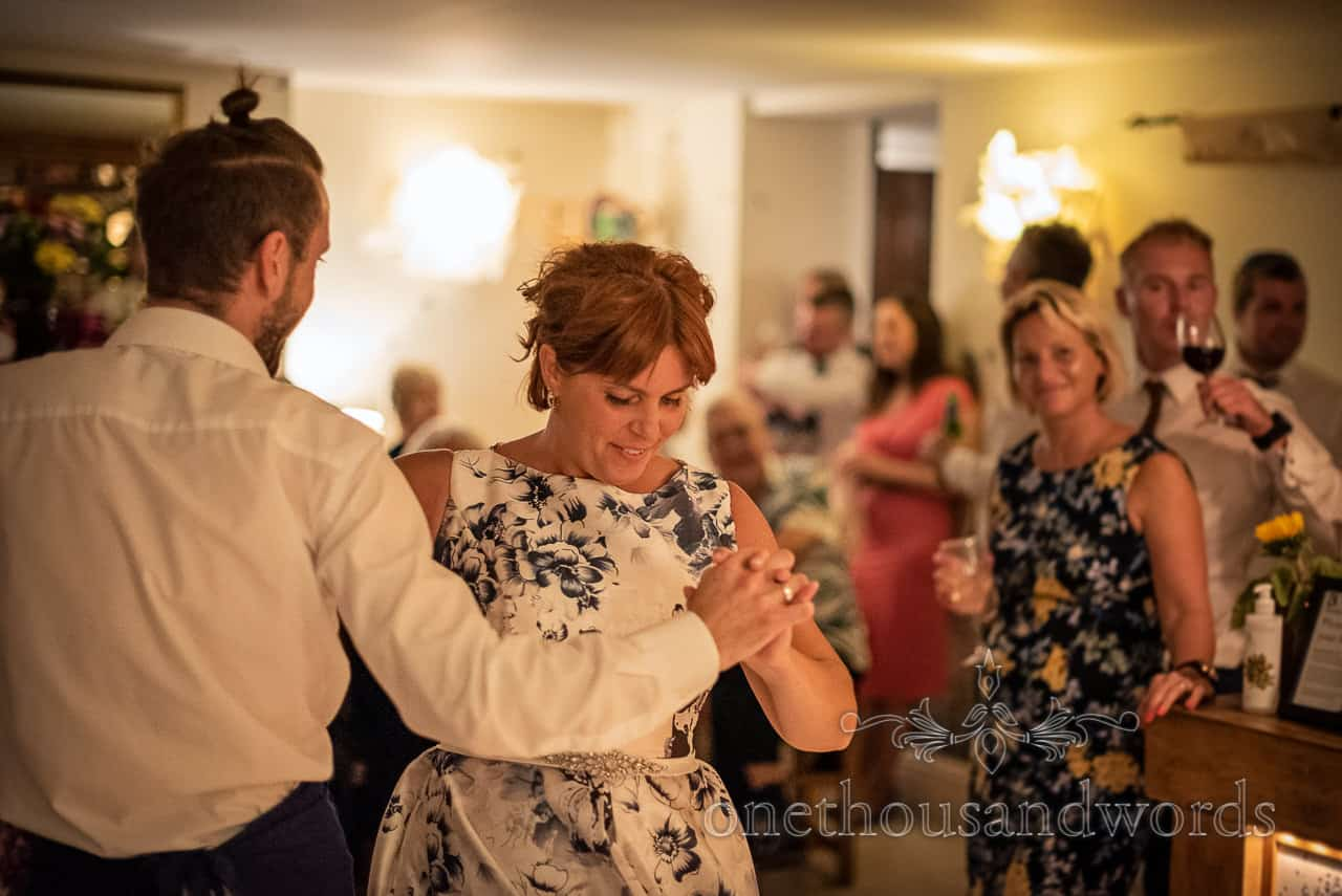 Bride dances to traditional Polish song on wedding evening in restaurant