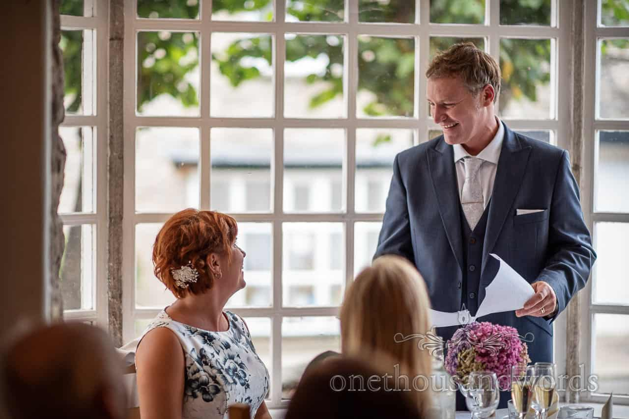 Groom laughs at bride during wedding speeches