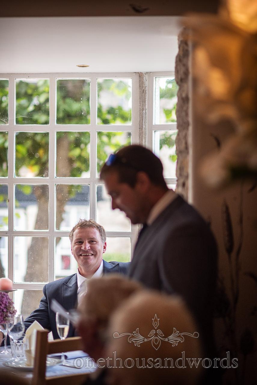 Groom sat in window laughs at best man's wedding speech