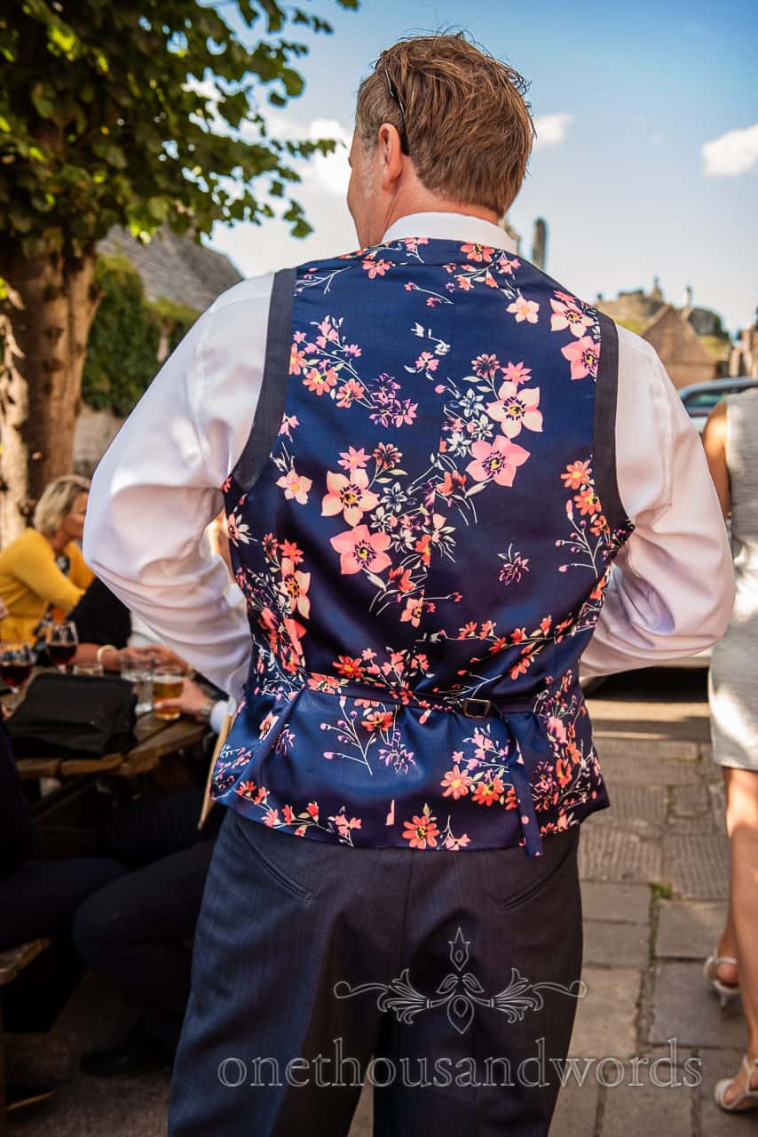 Groom's tailored blue and pink floral pattern waistcoat photograph