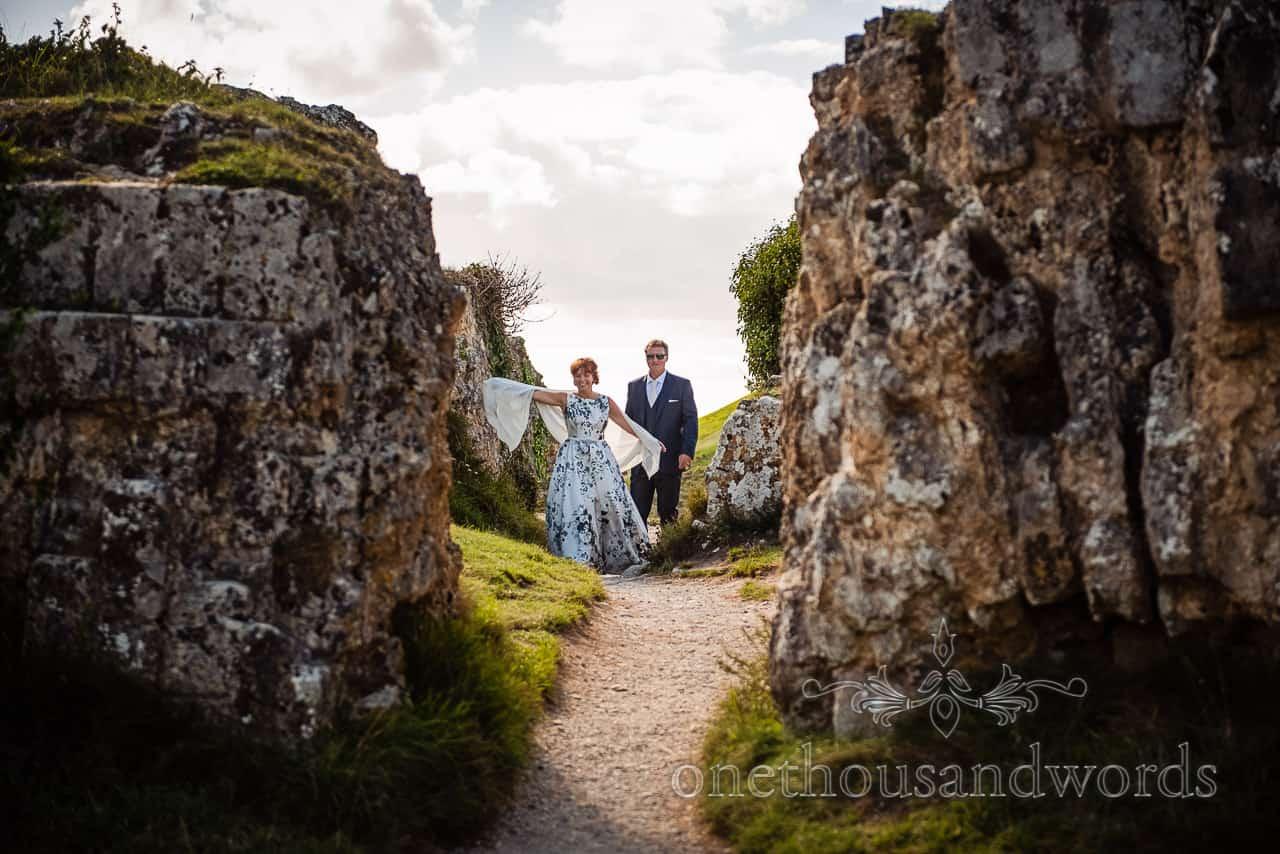 Happy bride and groom explore the ruins at Corfe Castle, Dorset